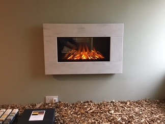 Newdawn Electric Fires shown in Witch Hazel, flat wall fix, no recess required simply hang on the wall - On display in our showroom
