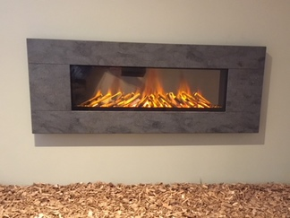 Newdawn 1500 Electric Fire shown in Lavarock, flat wall fix, no recess required, simply hang on the wall - On display in our showroom