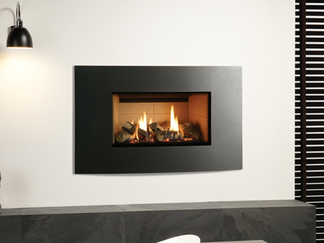 The Riva2 670 Verve XS gas fire offers the same subtly curving form as the Riva2 530 & Riva2 670 Verve gas fire but with slimmer proportions to offer a different aesthetic appeal for narrower walls or spaces.  The Riva2 670 Verve XS gas fire comes in smart Graphite or can be finished in one of four striking additional colour options to suit your interior tastes. The highly realistic fire is enhanced by Gazco's stunning glowing ember bed, offering all the ambiance of a real log flame in the modern convenience of a high efficiency gas fire.  Finishes: Graphite, Metallic Red, Metallic Bronze, Metallic Blue and Ivory.  Linings: Vermiculite, Brick effect and Black Reeded.  Fuel Bed: Logs.  Command Controls: Thermostatic remote.£