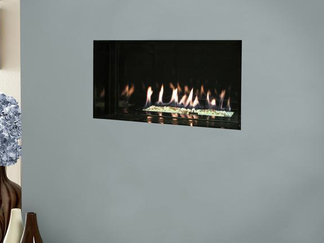 The Kinder Atina HE's perfect petite proportions and fabulous black reflective interior combined with a spellbinding flame makes this little hole in the wall gas fire a magnificant centre-piece for smaller modern living areas. The Atina HE high efficiency hole in the wall gas fire features a maximum heat output of 3.5kW (77% efficiency) and is controlled by a fully sequential remote control system with thermostatic operation so you can always maintain a comfortable room temperture that suits you. This fire can be installed as a trimless appliance or with a choice of Wide fascia in antique brass or polished steel, or Glass fascia in silver or champagne.   Kinder Atina HE - High Efficiency Hole in the Wall Gas Fire Specification:  Safety Flame